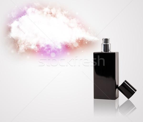 beautiful bottle spraying colorful cloud Stock photo © ra2studio