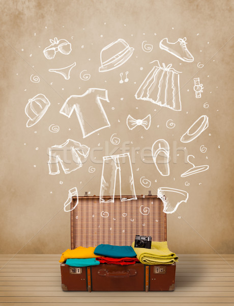 Traveler luggage with hand drawn clothes and icons Stock photo © ra2studio