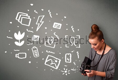 Photographer girl capturing white photography icons and symbols Stock photo © ra2studio