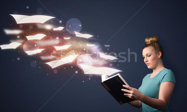 Fiatal hölgy olvas könyv repülés ki Stock fotó © ra2studio