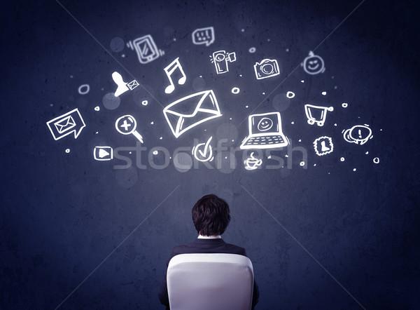Zdjęcia stock: Biznesmen · krzesło · multimedialnych · ikona · głowie · młodych