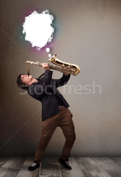 Joven jugando saxófono espacio de la copia blanco nube Foto stock © ra2studio