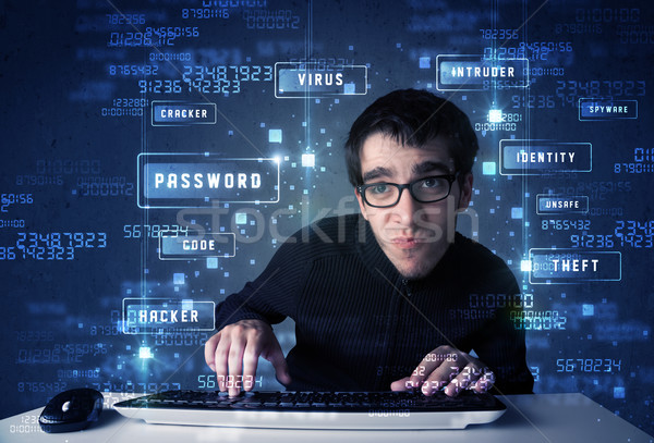 Hacker programing in technology enviroment with cyber icons  Stock photo © ra2studio