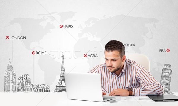 Businessman with world map and major landmarks of the world Stock photo © ra2studio