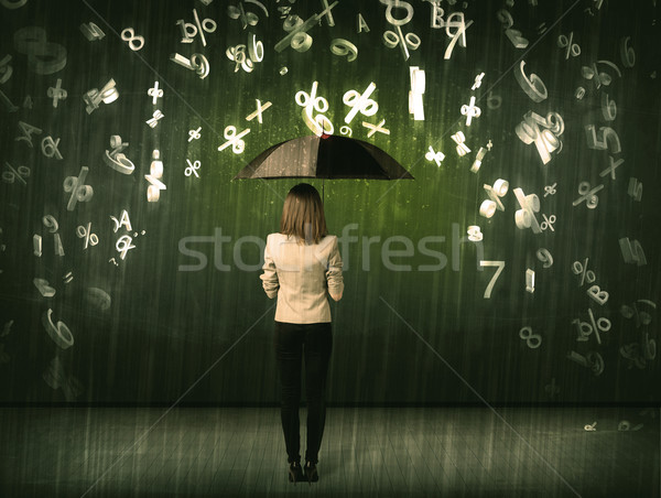 Businesswoman standing with umbrella and 3d numbers raining conc Stock photo © ra2studio