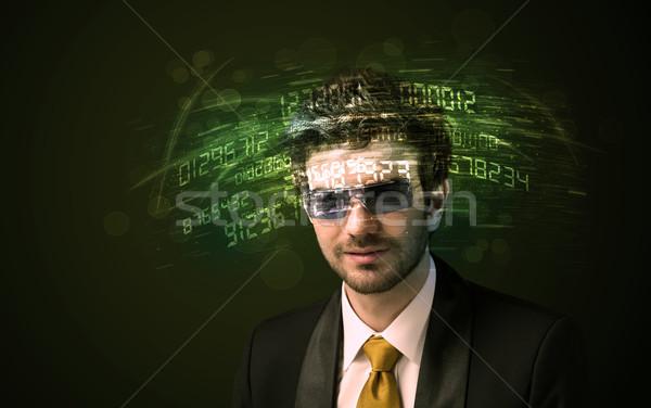 Uomo d'affari guardando alto tech numero computer Foto d'archivio © ra2studio