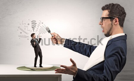 Angry businessman with weapon Stock photo © ra2studio