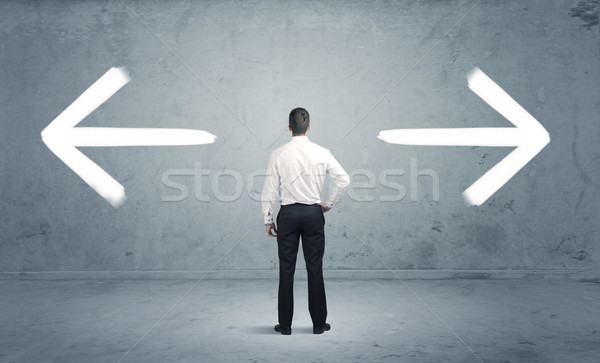 Confused business person choosing the way Stock photo © ra2studio