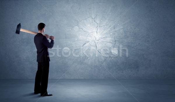 деловой человек стены молота служба бизнесмен Сток-фото © ra2studio