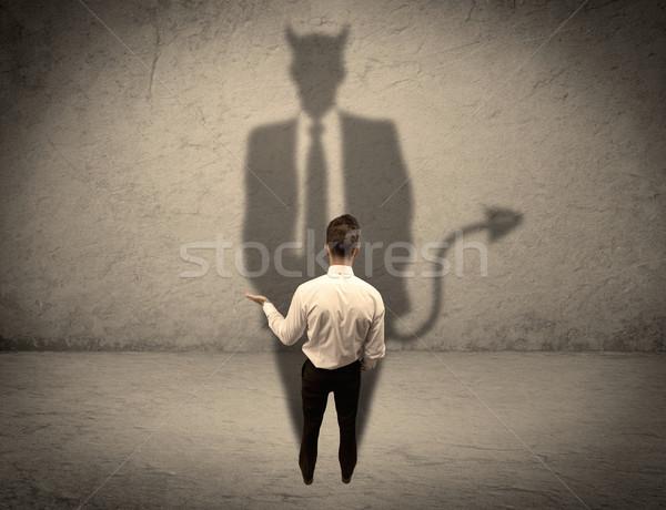 Stock fotó: Eladó · szemben · saját · ördög · árnyék · tapasztalt