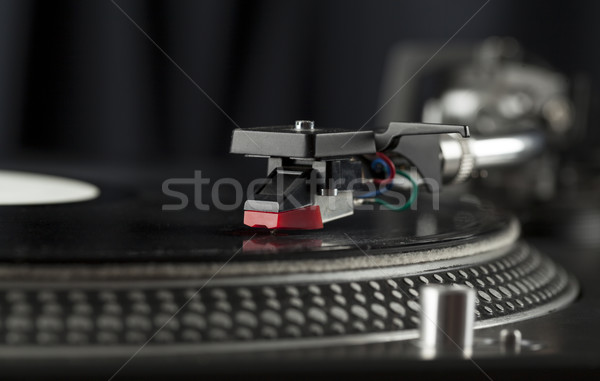 Stock photo: Turntable playing vinyl close up with needle on the record