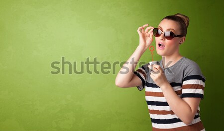 Gyönyörű nő fúj szappanbuborék copy space zöld nő Stock fotó © ra2studio