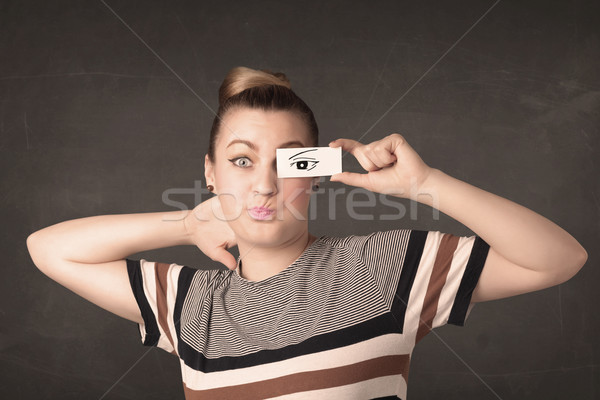 Silly youngster looking with hand drawn eye paper Stock photo © ra2studio