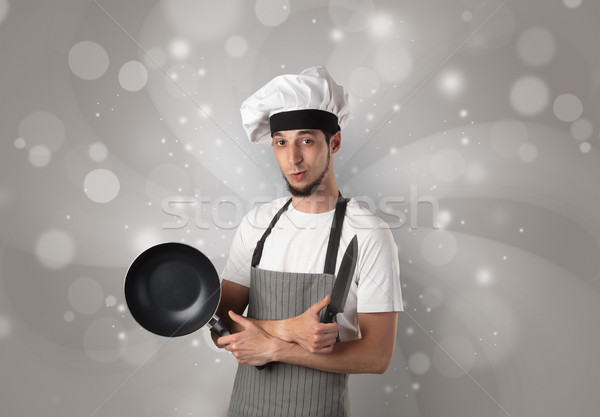 Male cook with shiny grey wallpaper Stock photo © ra2studio