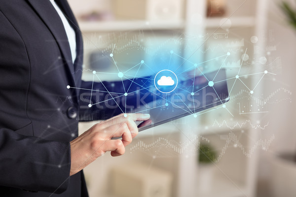 Business woman using tablet with cloud connection concept Stock photo © ra2studio