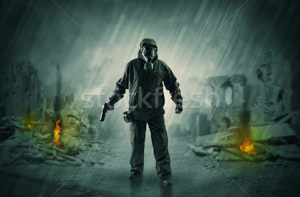 After catastrophe men coming in gas mask and arms Stock photo © ra2studio