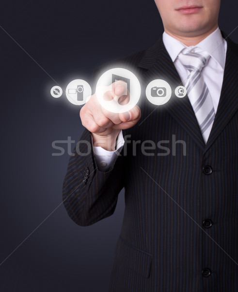 Man pressing media player button Stock photo © ra2studio