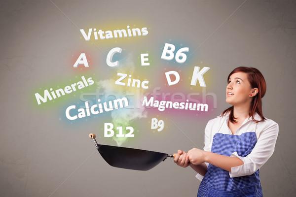 Fiatal nő főzés vitaminok ásványok csinos étel Stock fotó © ra2studio