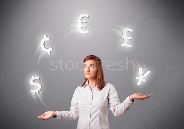 Jonge dame permanente jongleren valuta iconen Stockfoto © ra2studio