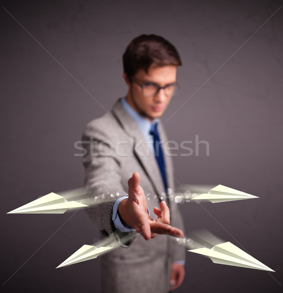 Knappe man origami vliegtuigen knap jonge man Stockfoto © ra2studio