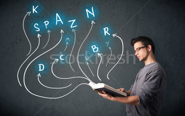 Young man reading a book while multiple choices are coming out of the book Stock photo © ra2studio