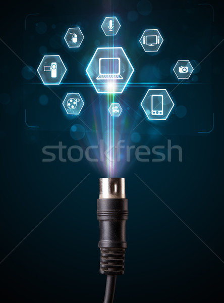 Electric cable with multimedia icons Stock photo © ra2studio