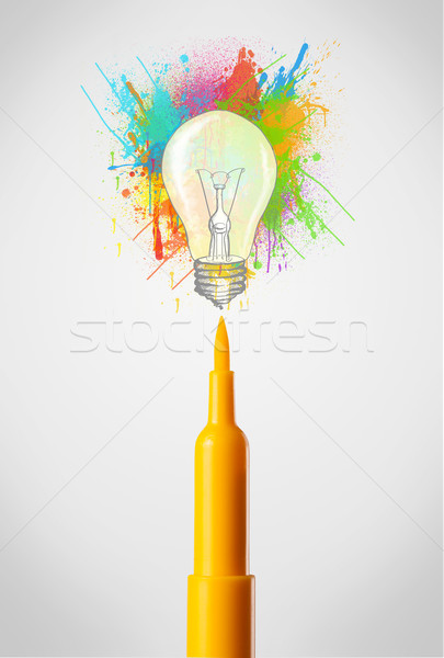 Felt pen close-up with colored paint splashes and lightbulb Stock photo © ra2studio