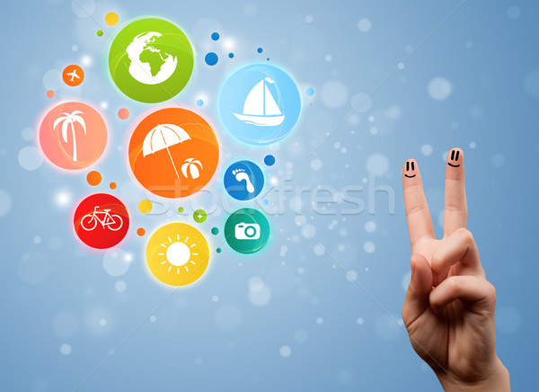 Cheerful happy smiling fingers with colorful holiday travel bubble icons Stock photo © ra2studio