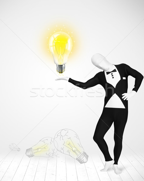 Man in full body with glowing light bulb Stock photo © ra2studio