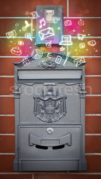 Colorful icons and symbols bursting out of a mailbox Stock photo © ra2studio