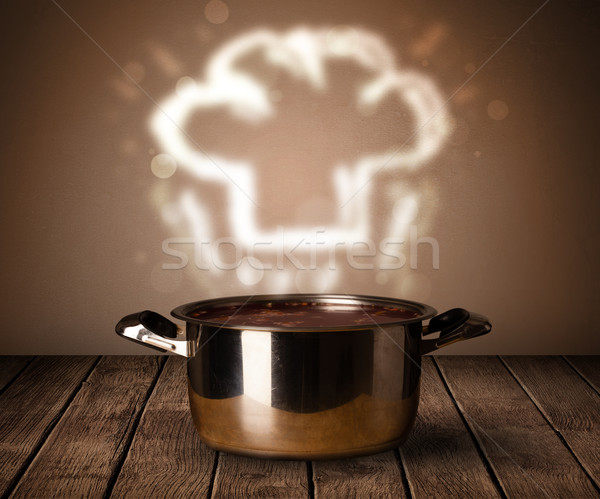 Chef hat above cooking pot Stock photo © ra2studio