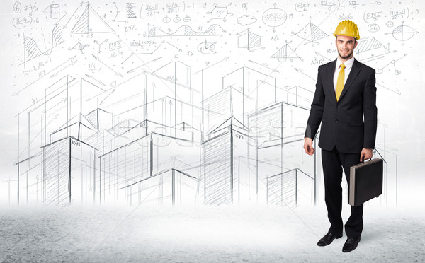 Handsome construction specialist with city drawing in background Stock photo © ra2studio