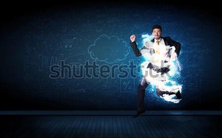 Heureux homme d'affaires sautant tempête nuage autour Photo stock © ra2studio
