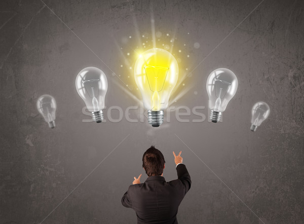 Business person having an idea light bulb concept Stock photo © ra2studio