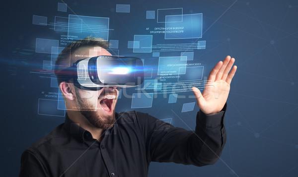 Businessman with virtual reality goggles Stock photo © ra2studio