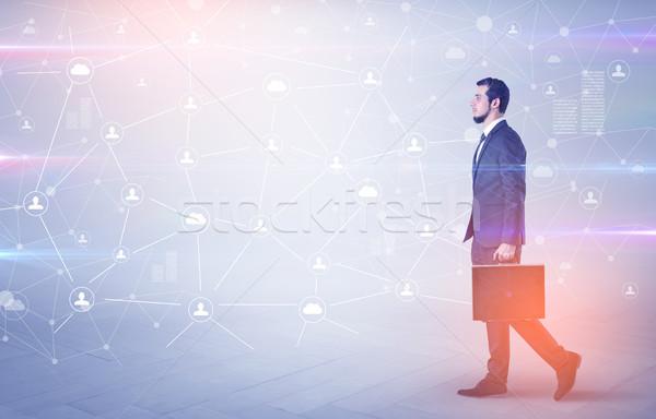 Man walking with online community wallpaper Stock photo © ra2studio