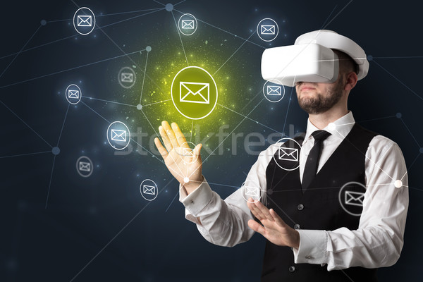 Man in vr goggles and online communication concept Stock photo © ra2studio