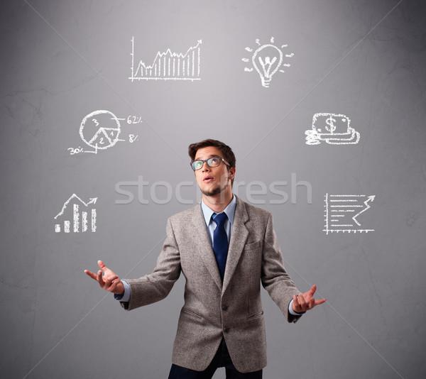 Fiatal srác zsonglőrködés statisztika grafikonok áll kéz Stock fotó © ra2studio