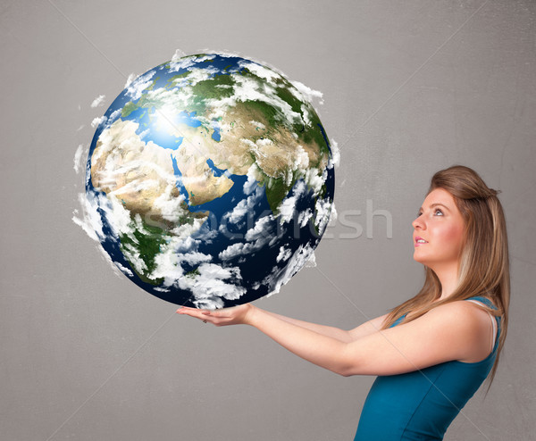 Stock photo: Pretty girl holding 3d planet earth