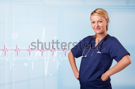 Pretty medical doktor listening to red pulse and heart rates Stock photo © ra2studio