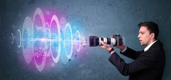 Photographer making photos with powerful light beam Stock photo © ra2studio