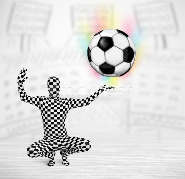 man in full body suit holdig soccer ball Stock photo © ra2studio