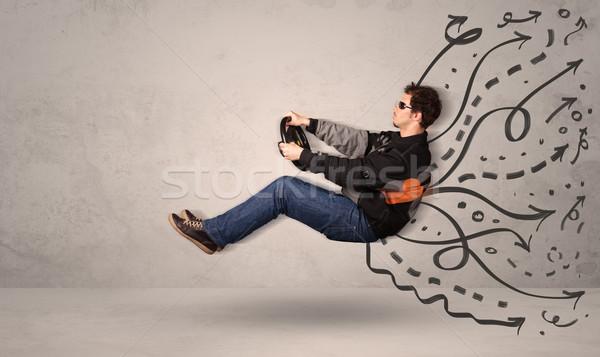 Drôle homme conduite battant véhicule dessinés à la main Photo stock © ra2studio