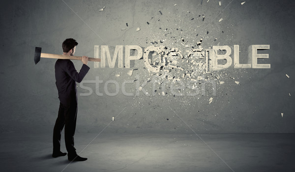 деловой человек невозможное знак молота стены Сток-фото © ra2studio