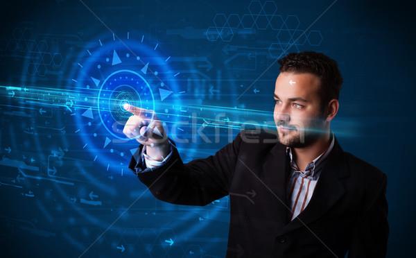 Yakışıklı teknoloji adam yüksek teknoloji kontrol paneli Stok fotoğraf © ra2studio