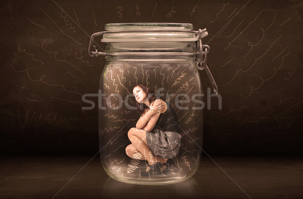 Businesswoman inside a jar with powerful hand drawn lines concep Stock photo © ra2studio
