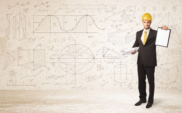 Handsome engineer calculating with hand drawn background Stock photo © ra2studio