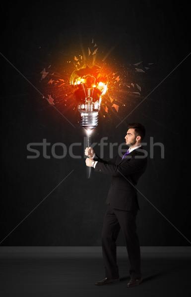 Biznesmen wybuchu żarówki czarny uśmiech moc Zdjęcia stock © ra2studio