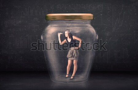 Businessman inside a glass jar with lightning drawings concept Stock photo © ra2studio