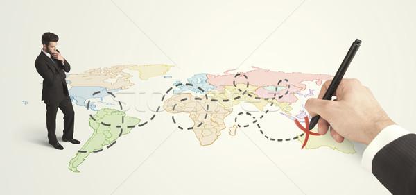 Empresario mirando mapa ruta mano Foto stock © ra2studio
